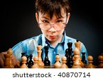 Nerd play chess on a black  background - stock photo