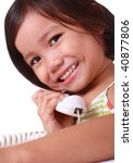 young asian girl talking on the telephone - stock photo