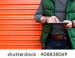 young man using a tablet in... | Shutterstock . vector #408838069