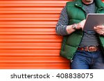 young man using a tablet in... | Shutterstock . vector #408838075