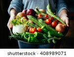 hands holding big plate with... | Shutterstock . vector #408989071