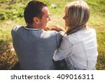 beautiful couple sitting on the ... | Shutterstock . vector #409016311