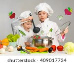 cooking little boy and girl...