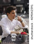 handsome man drinking espresso... | Shutterstock . vector #409042591