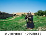knight with sword. praying | Shutterstock . vector #409058659