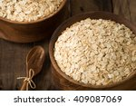 rolled oats  oats in bowl and... | Shutterstock . vector #409087069