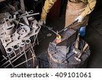 male hands in the production... | Shutterstock . vector #409101061