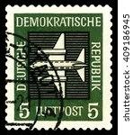 Small photo of STAVROPOL, RUSSIA - APRIL 05, 2016: a stamp printed by GDR shows Stilized plane, payment airmail, circa 1957