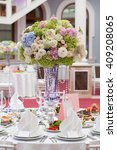 table setting at a luxury... | Shutterstock . vector #409208065