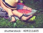 woman feet on grass in flat...   Shutterstock . vector #409211605