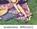woman feet on grass in flat... | Shutterstock . vector #409211611