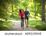 young couple jogging at the... | Shutterstock . vector #409219045
