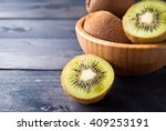 Kiwi Fruit In A Bowl On Wooden...