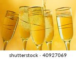 Champagne flutes making a toast.. Sample text - stock photo