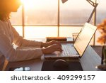 female teleworker texting using ... | Shutterstock . vector #409299157