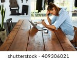 Small photo of Business Woman Having Headache While Working Using Laptop Computer. Stressed And Depressed Girl Touching Her Head, Feeling Pain While Sitting At Wooden Table At Cafe. Work Failure Concept