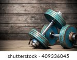 vintage dumbbells on the wooden ... | Shutterstock . vector #409336045