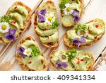 canapes with avocado paste and... | Shutterstock . vector #409341334