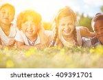 happy interracial group of kids ... | Shutterstock . vector #409391701