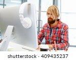 handsome businessman in office   Shutterstock . vector #409435237