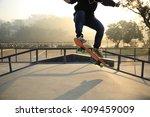 skateboarding woman at sunrise... | Shutterstock . vector #409459009