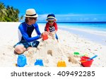 father and son building sand... | Shutterstock . vector #409492285