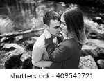 cuddling couple stay at stones...   Shutterstock . vector #409545721