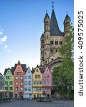 "Small photo of COLOGNE, GERMANY - APRIL 14: Colorful houses and the roman Church ""Gross Sankt Martin"" in the old town of Cologne, Germany."