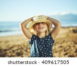 happy adorable young girl on... | Shutterstock . vector #409617505