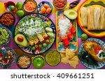 green and red enchiladas with... | Shutterstock . vector #409661251