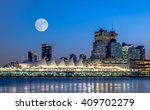Stock photo full moon over the city downtown vancouver bc canada 409702279