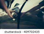 hand on handle. close up of man ... | Shutterstock . vector #409702435