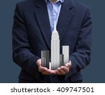 businessman holding... | Shutterstock . vector #409747501