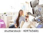 nice girl giving headphones to... | Shutterstock . vector #409765681