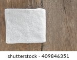 white towel on old wood. | Shutterstock . vector #409846351
