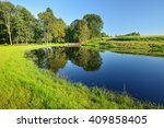 calm countryside lake with a... | Shutterstock . vector #409858405