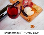 red wine  cheese  basil and... | Shutterstock . vector #409871824