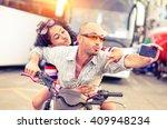 couple of bikers taking selfie... | Shutterstock . vector #409948234