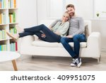 young smiling couple relaxing...   Shutterstock . vector #409951075