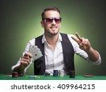 winner poker player at the table   Shutterstock . vector #409964215