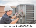hvac technician working on a... | Shutterstock . vector #410003134