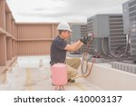 technician taking a cover plate ... | Shutterstock . vector #410003137