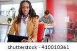 confident female designer... | Shutterstock . vector #410010361