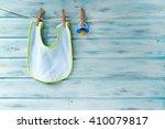 baby bib and pacifier hanging...   Shutterstock . vector #410079817