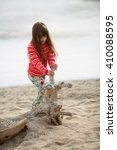 little girl playing in nature | Shutterstock . vector #410088595