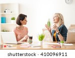 cheerful two female colleagues... | Shutterstock . vector #410096911
