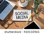 social media open book on table ... | Shutterstock . vector #410110561