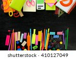 colourful stationery on black... | Shutterstock . vector #410127049