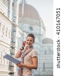 Small photo of An amble around awe-inspiring Duomo in Florence, Italy. Portrait of happy woman tourist with a map having audio walking tour