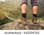 hiker shoes on hiker legs... | Shutterstock . vector #410204761